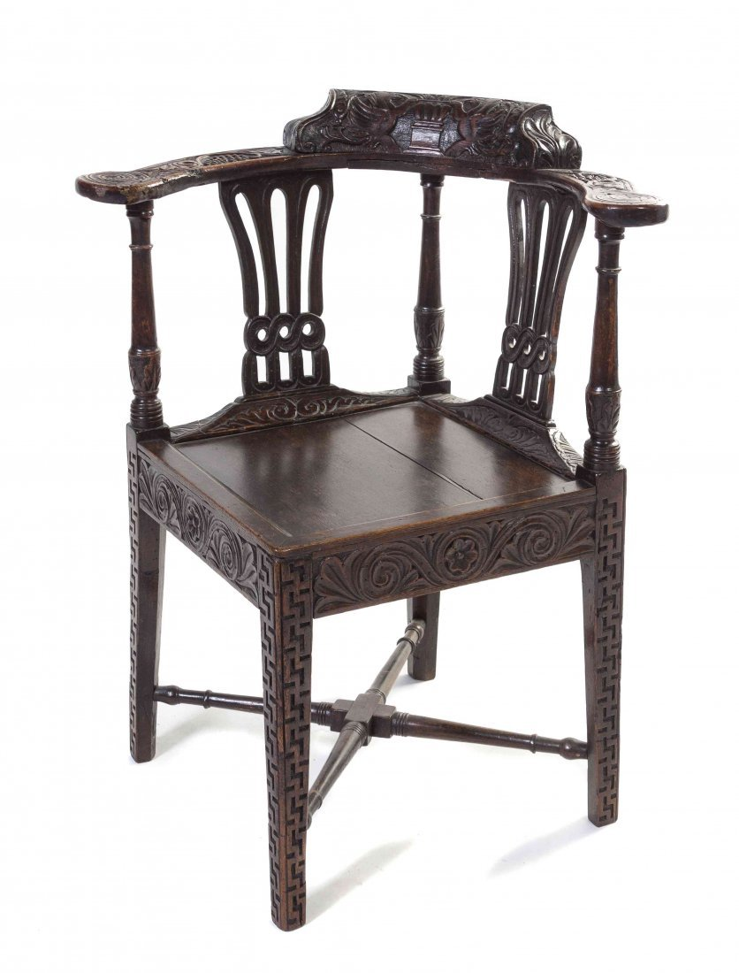 An English Oak Corner Chair, Height 32 1/2 inches.