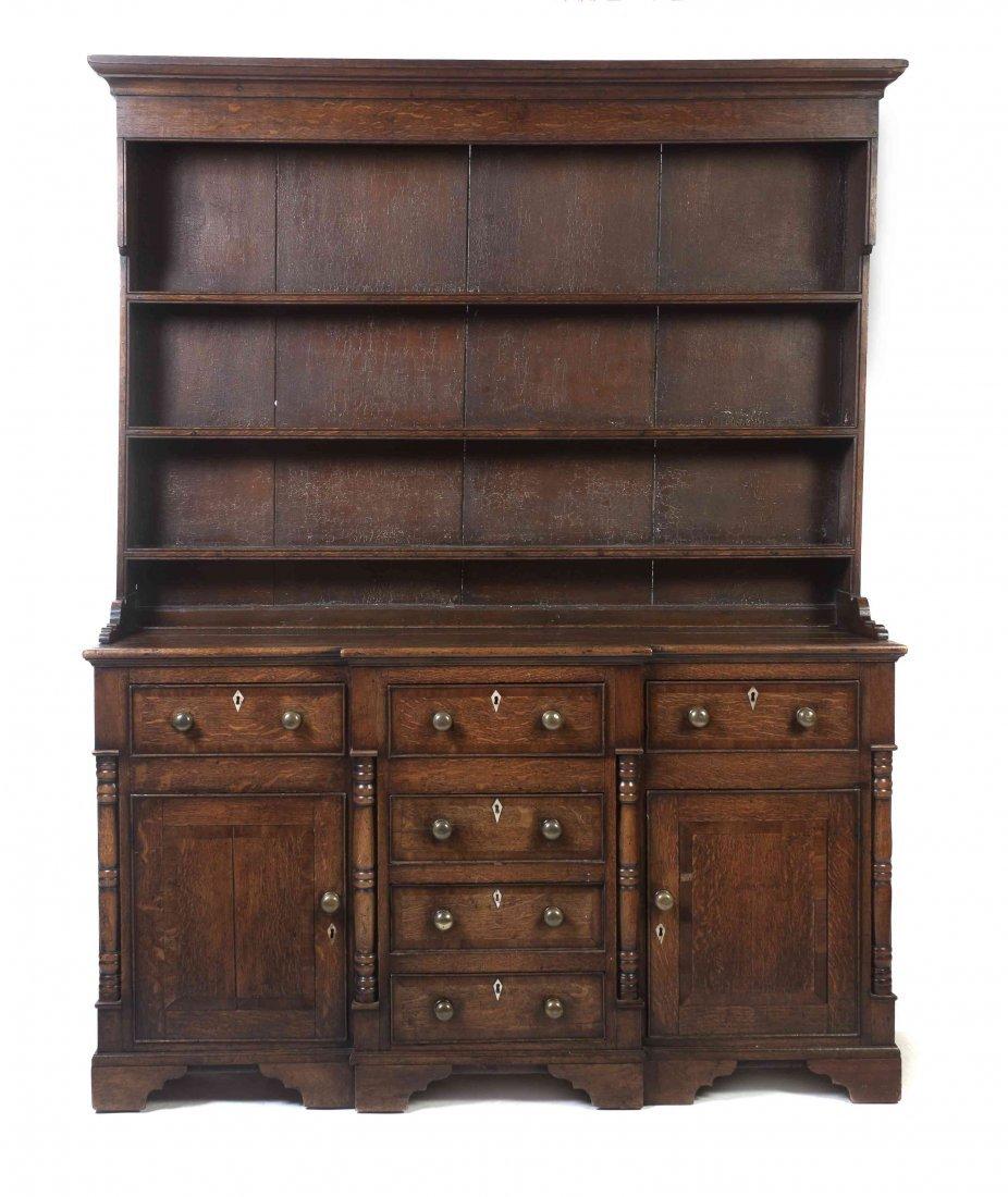 A Cockbeaded Oak Welsh Dresser, Height 84 1/2 inches.
