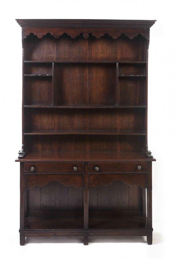 An Oak Welsh Dresser, Height 75 x width 47 1/2 x depth