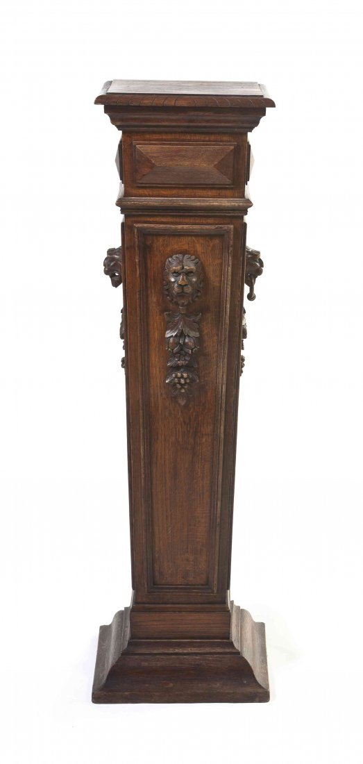 A Neoclassical Carved Oak Pedestal, Height 46 inches.
