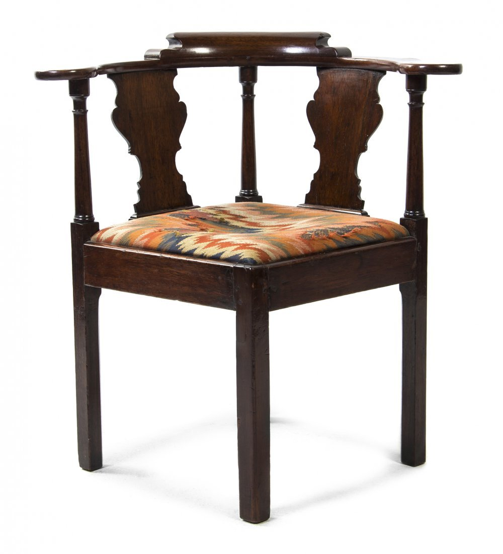 An English Mahogany Corner Chair, Height 30 3/4 inches.