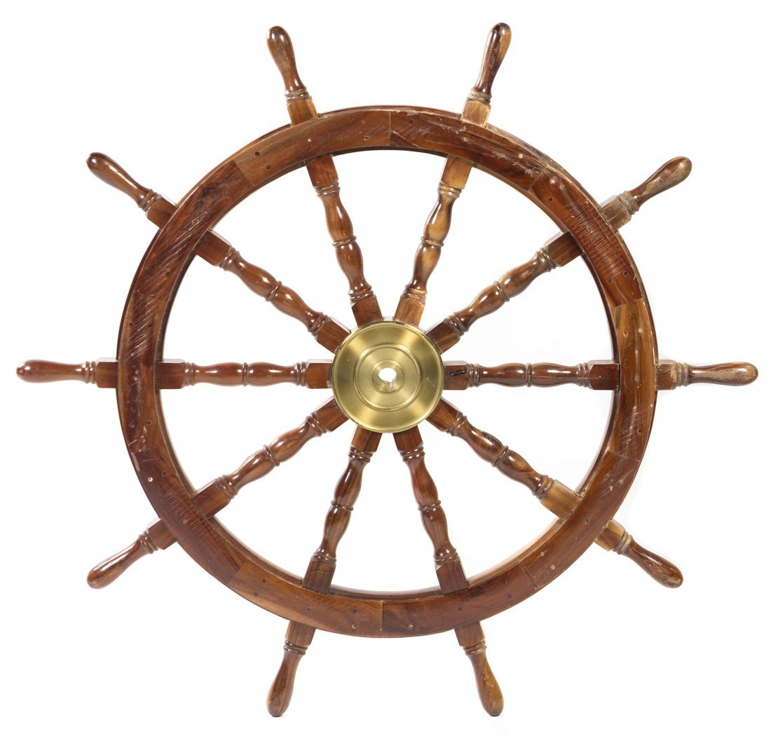 A Mahogany and Brass Ship Wheel, Diameter 45 inches.