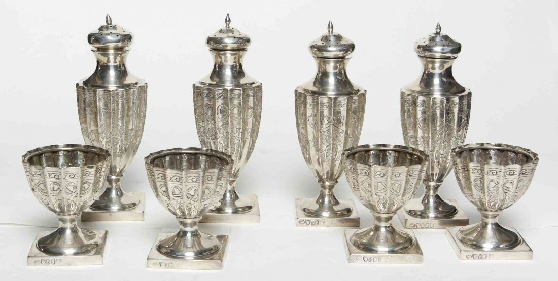 A Set of Four Silver Caster and Four Matching Salts,
