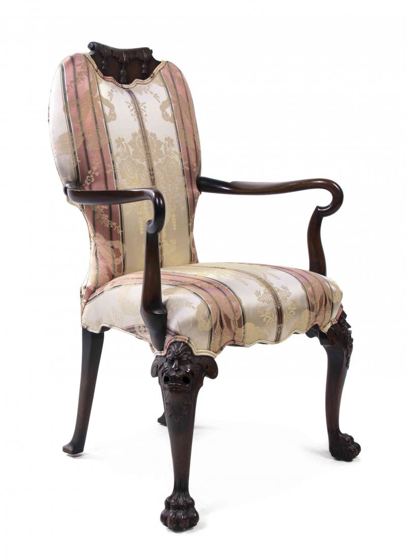 A Victorian Mahogany Open Armchair, Height 42 3/4