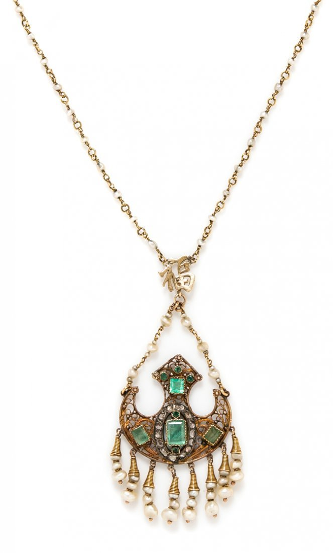 A Silver Topped Gold, Emerald, Seed Pearl and Diamond
