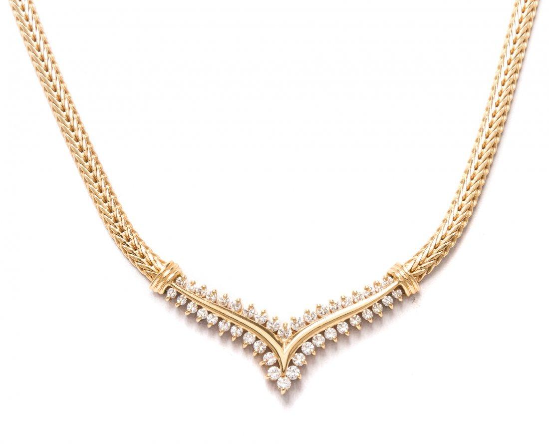 A 14 Karat Yellow Gold and Diamond Necklace, 12.10