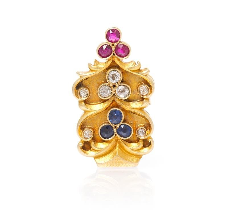 An 18 Karat Yellow, Gold, Diamond, Sapphire and Ruby