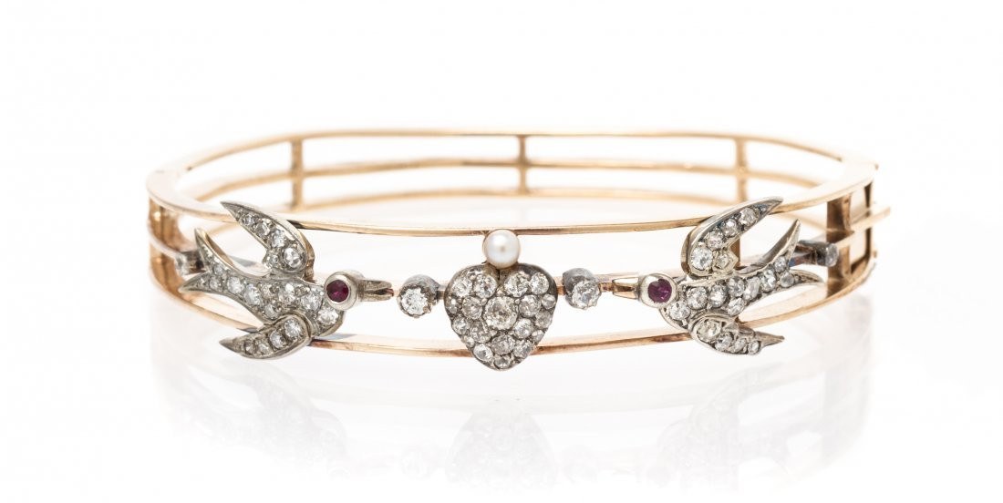A Silver Topped Yellow Gold, Diamond, Ruby and Pearl