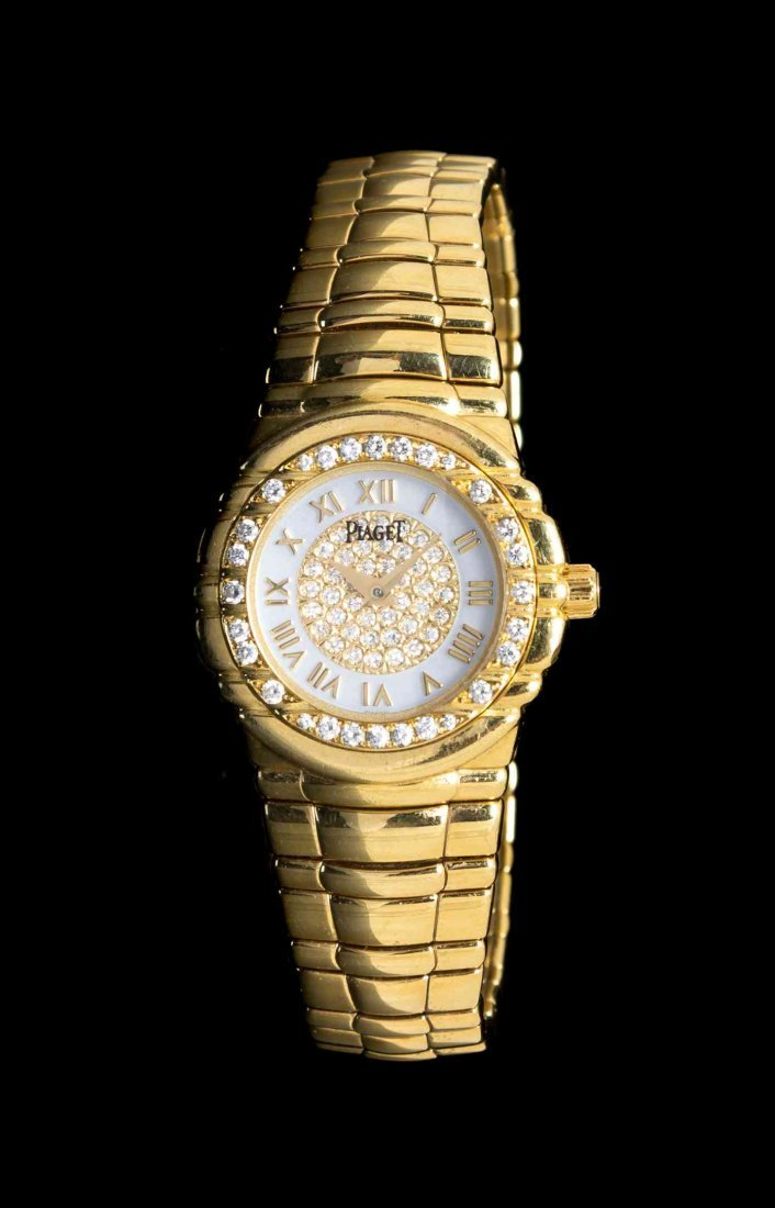 An 18 Karat Yellow Gold and Diamond Tanagra Watch,