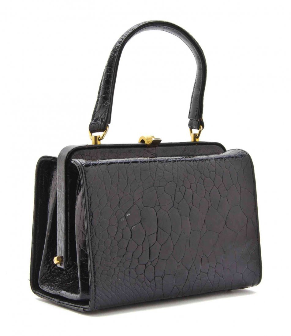 A Black Turtle Leather Bag, 7 x 6 x 3 inches.