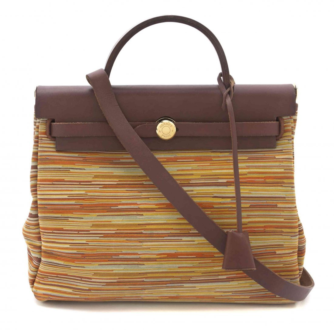 An Hermes 32 cm Chocolate Leather Vibrato Kelly Bag,