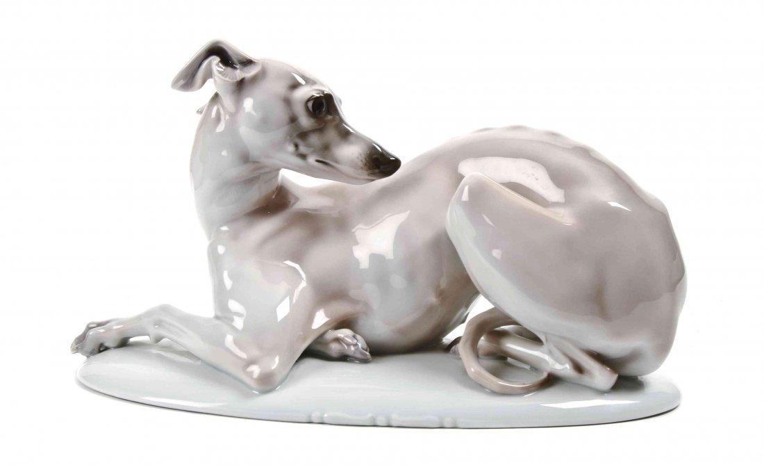 A Rosenthal Porcelain Figure of a Reclining Greyhound,