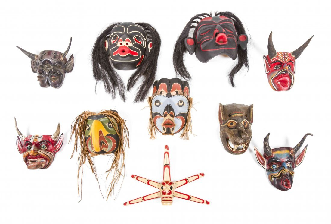 Ten Painted Wood Masks, Height of tallest 14 inches.