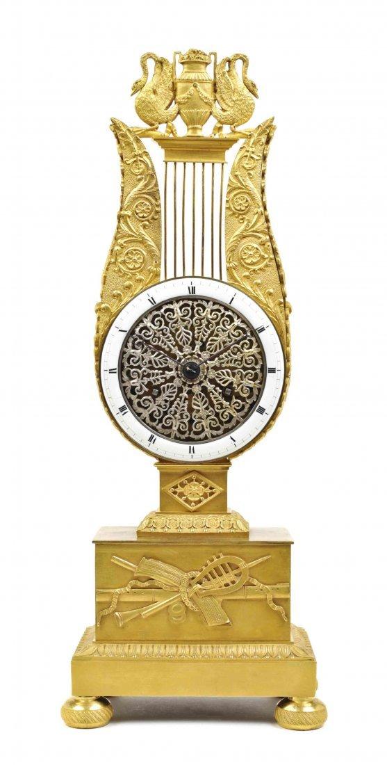 An Empire Style Gilt Bronze Mantel Clock, Height 17