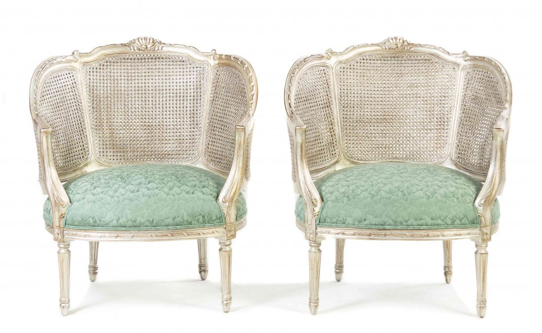 A Pair of Louis XVI Style Silvered Caned Bergeres,