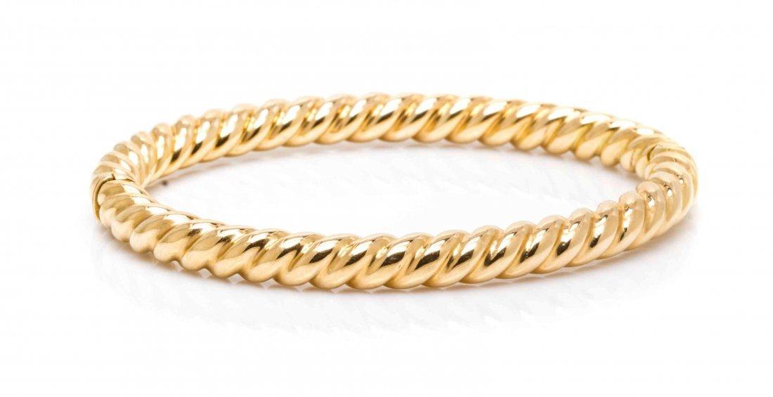 A 14 Karat Yellow Gold Bangle Bracelet, 18.90 dwts.