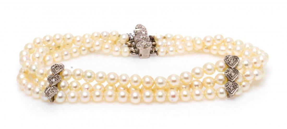 A White Gold, Diamond and Cultured Pearl Multi Strand