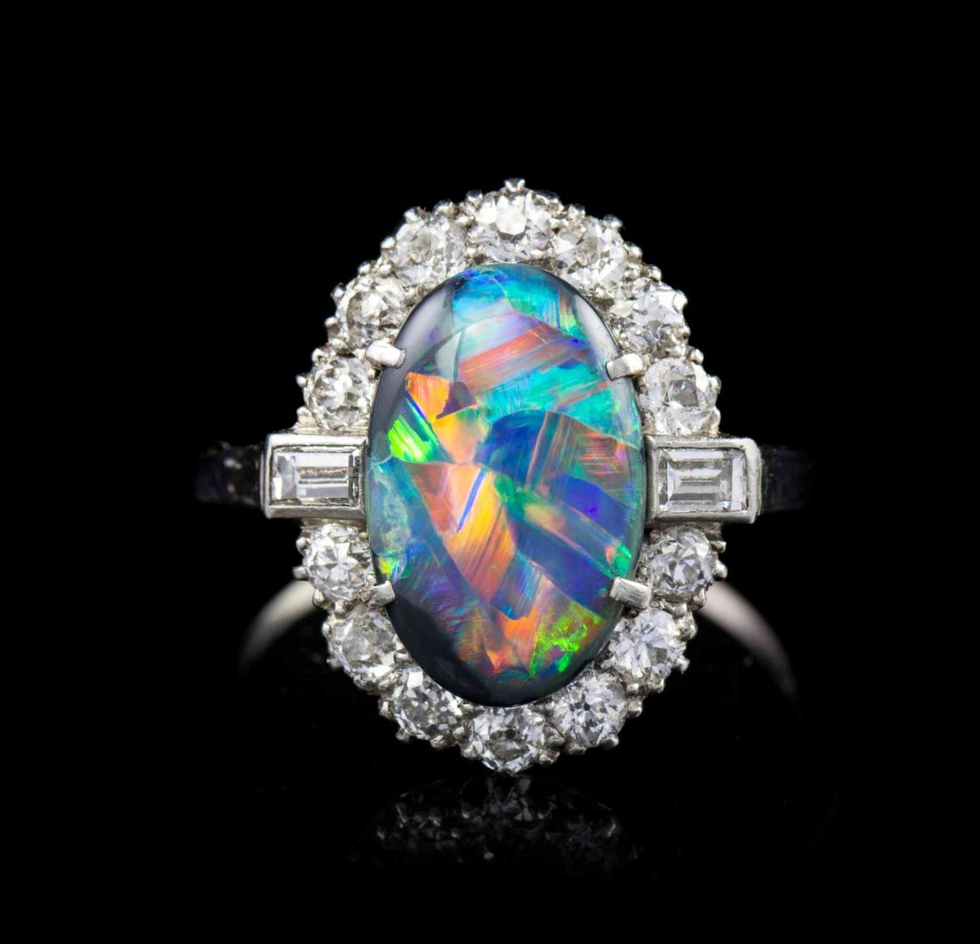 An Art Deco Platinum, Black Opal and Diamond Ring, 4.10