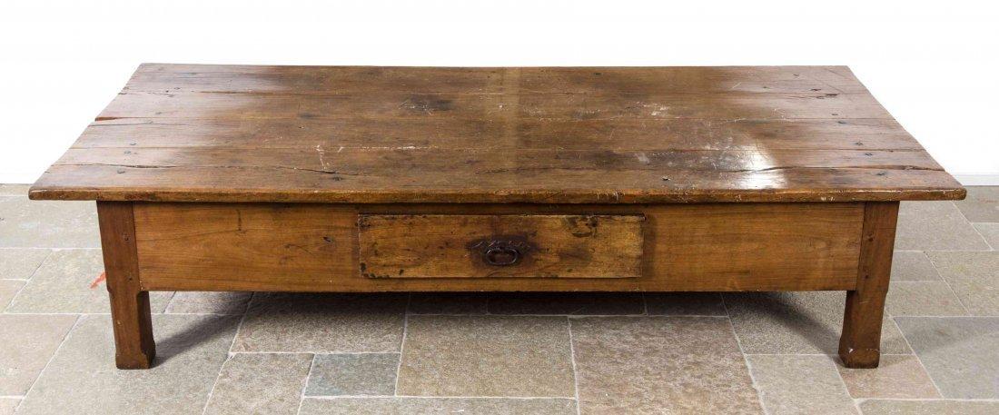 A Walnut Low Table, Height 18 x width 77 x depth 38