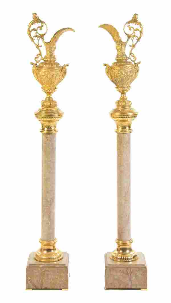 A Pair of Neoclassical Gilt Bronze Ewers on Marble