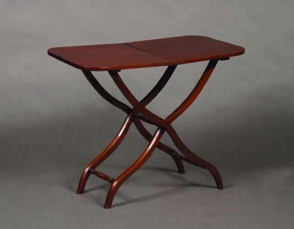 1: A Mahogany Coach Table,