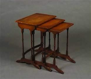 A Nest of Three Mahogany Tables.