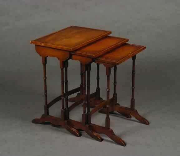 7: A Nest of Three Mahogany Tables.