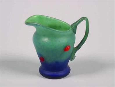 495: A Mottled Glass Ewer,