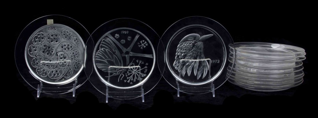 A Set of Twelve Lalique Molded and Frosted Glass Annual