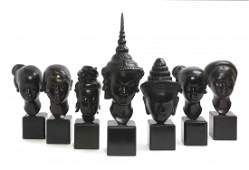 A Collection of Seven Bronze Asian Heads, Height of