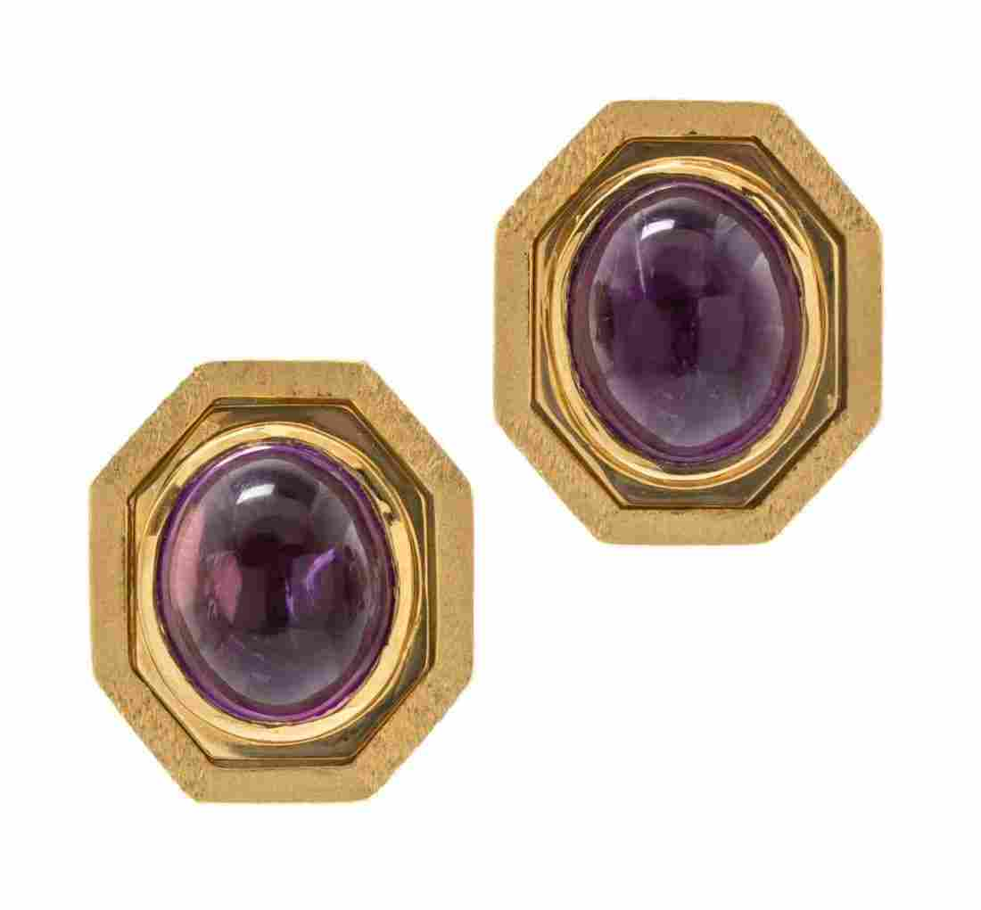A Pair of 14 Karat Yellow Gold and Amethyst Earclips,