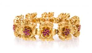 An 18 Karat Yellow Gold and Ruby Flower Bracelet