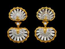 A Pair of 18 Karat Gold and Diamond Earclips