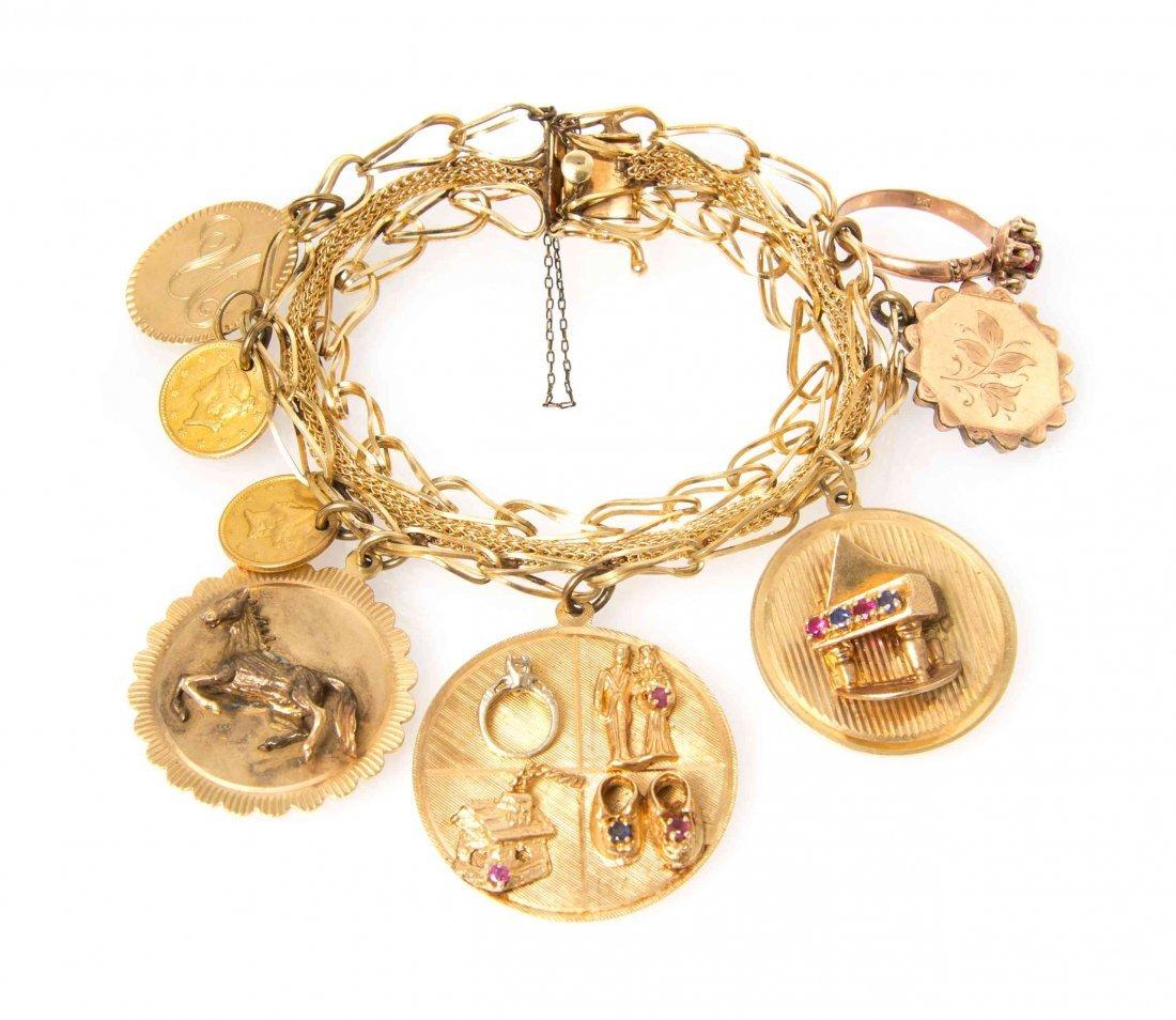 A 14 Karat Yellow Gold Charm Bracelet with Eight