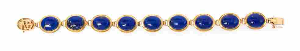 A 14 Karat Yellow Gold and Lapis Lazuli Bracelet, 12.70