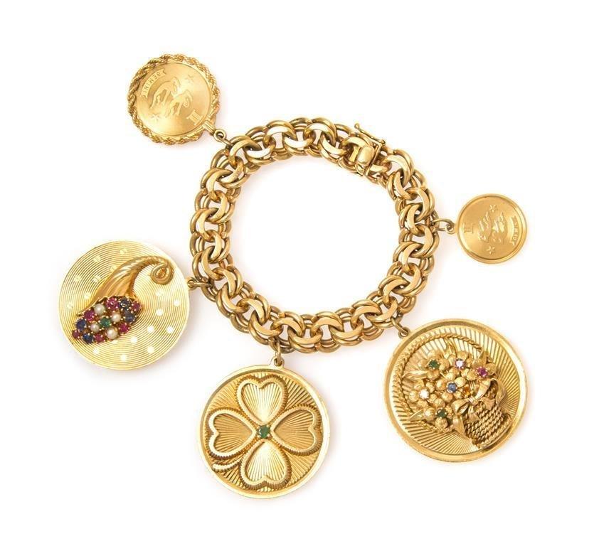 A 14 Karat Yellow Gold Charm Bracelet with Five