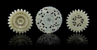 A Group of Three Carved Jade Plaques, Diameter of large