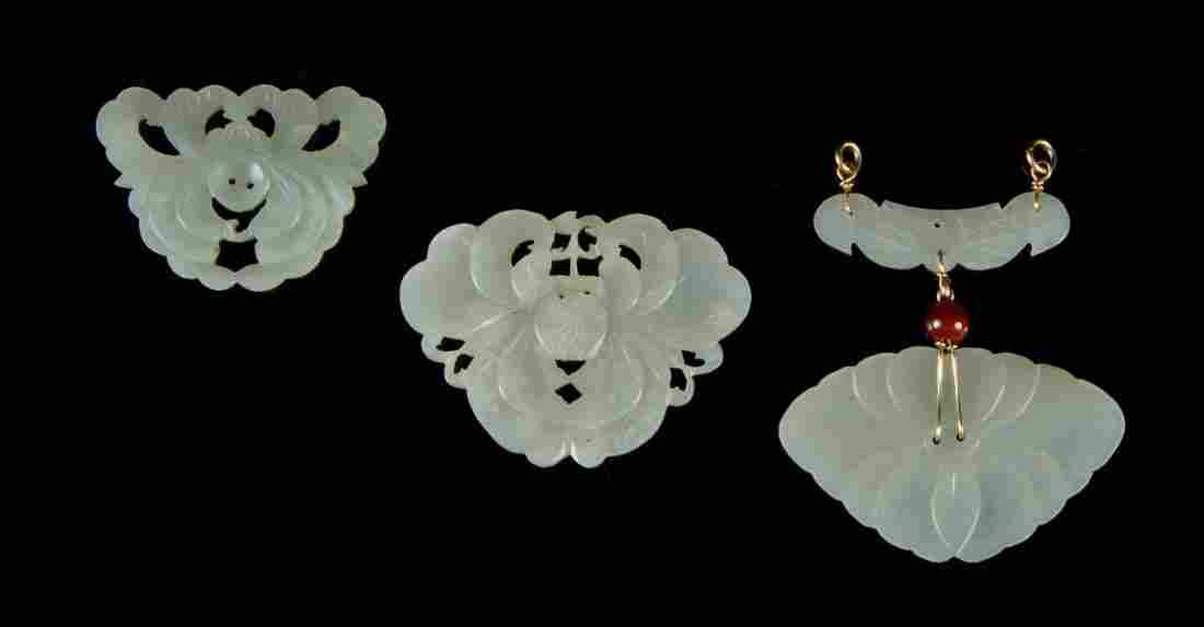 A Group of Three Foliate Carved Jade Plaques, Width of