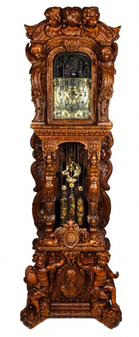 A Monumental English Carved Oak Tall Case Clock, LAST