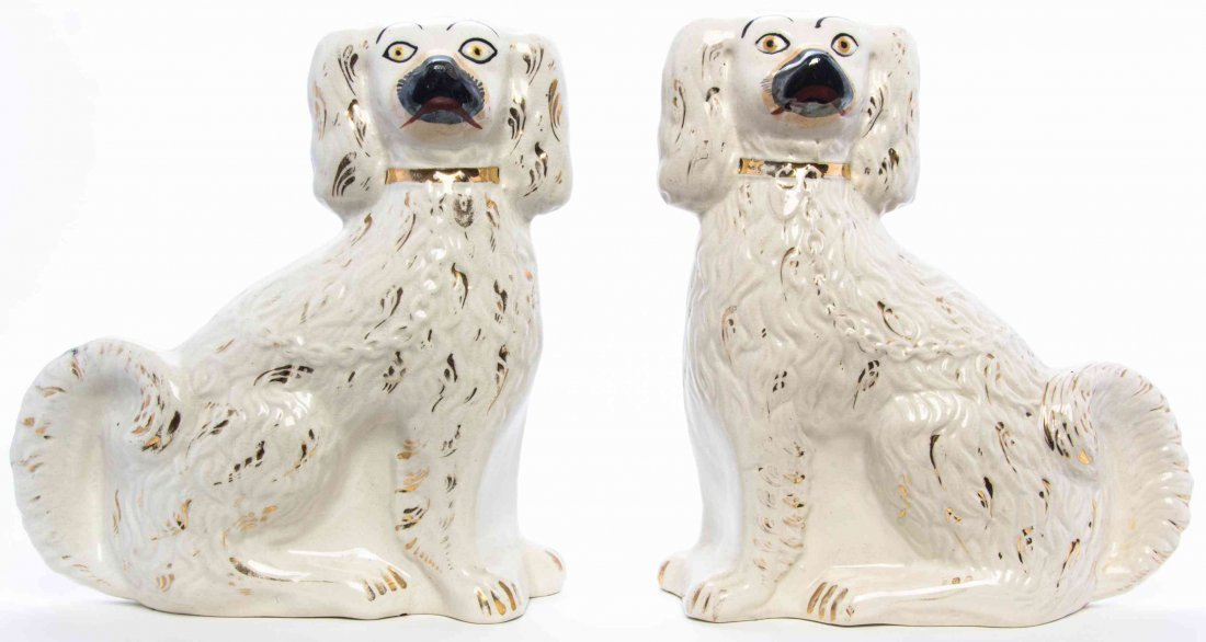 A Pair of Staffordshire Earthenware Dogs, Height 9 1/2
