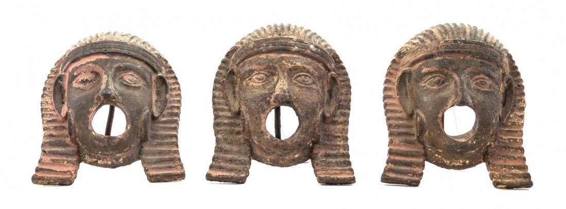 A Set of Three Egyptian Style Iron Masks, Height 6 3/4