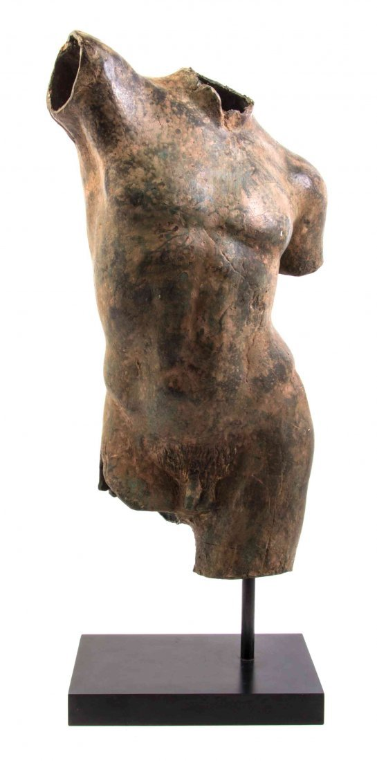 A Patinated Bronze Torso, Height 23 1/4 inches