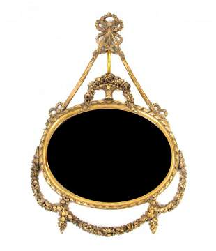 A Louis XVI Style Giltwood Mirror, FIRST HALF 20TH