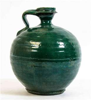 A Green Glazed Water Vessel, Height 10 1/4 inches.