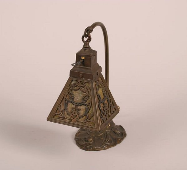 16: An Art Noveau Bronze and Slag Glass Lamp,