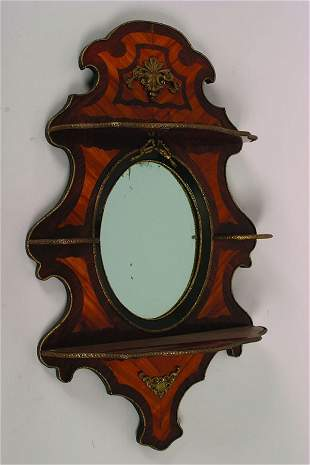 A Louis XVI Style Gilt Metal Mounted Kingwood and R