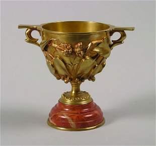 A Gilt Bronze Handled Cup,