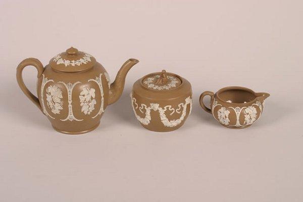 499: An English Glazed Brown Stoneware Assembled Tea Se