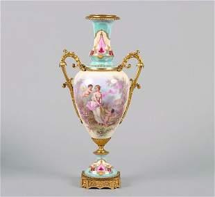A Gilt Bronze Mounted Sevres Porcelain Urn,
