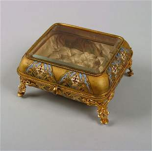 A French Gilt-Metal and Champleve Lidded Box,